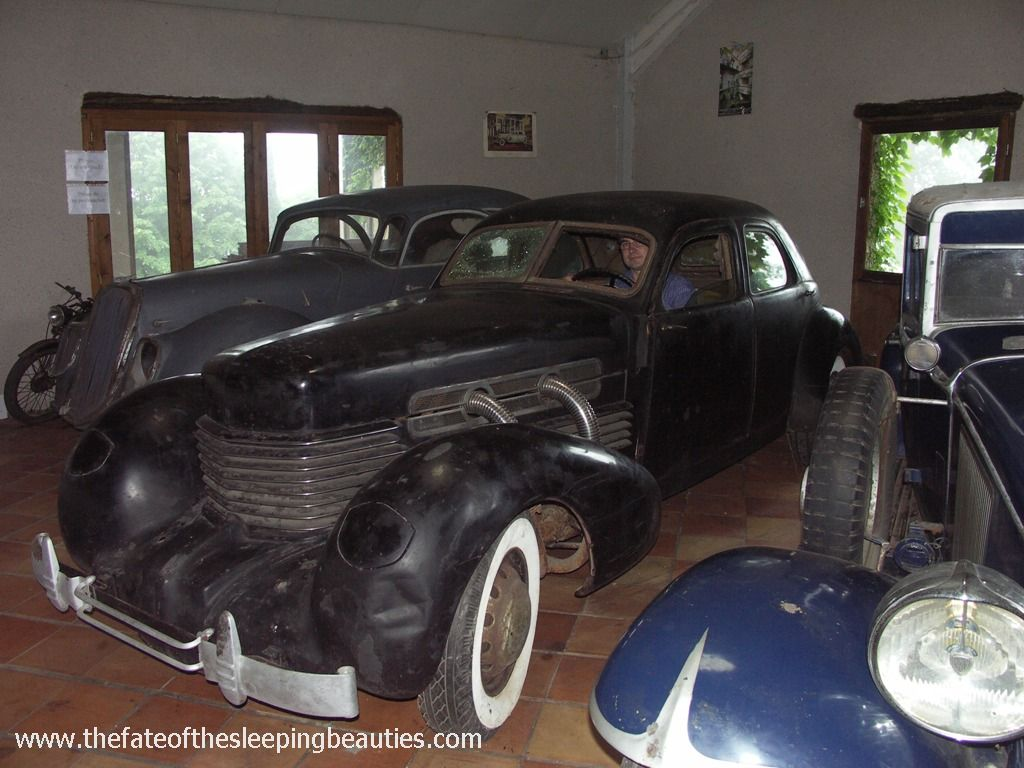 1937 Cord 812 Supercharger Custom Berline between two other unrestored Sleeping Beauties (photo Kay Hottendorff, 2007)